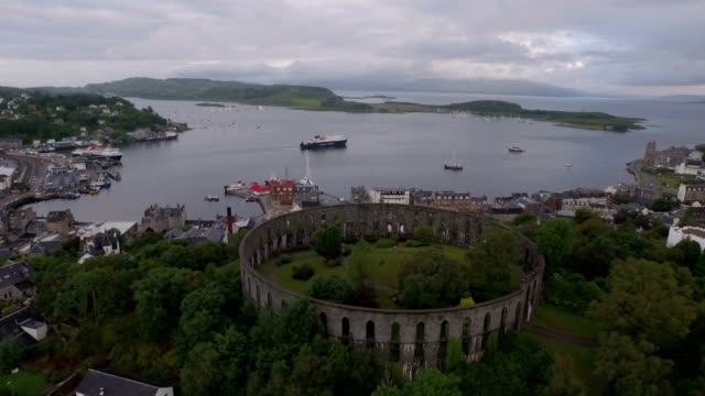 aerial shot of mccaigs tower in oban on the west coast of scotland - bay of water stock videos & royalty-free footage