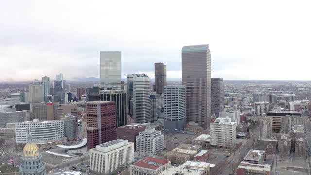 aerial shot of modern skyscrapers against sky, drone panning over city - denver, colorado - world politics stock videos & royalty-free footage