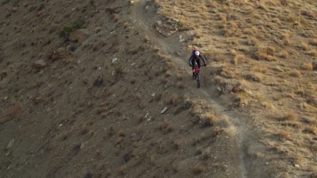 aerial shot of mountain biker riding along a ridge on 18 road in fruita, colorado - steep stock videos and b-roll footage