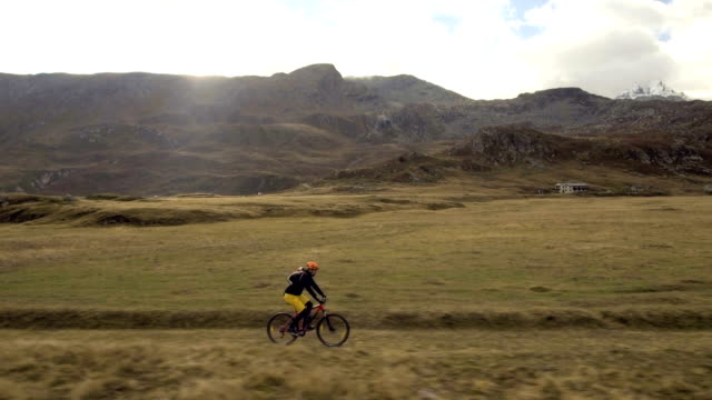 Aerial shot of mountain biker riding the trail