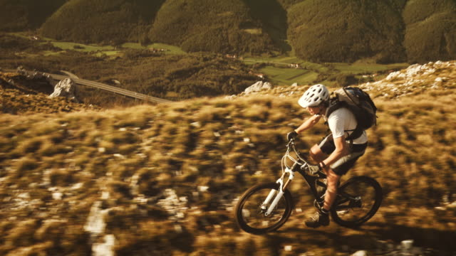 Aerial shot of mountain biker riding up the ridge