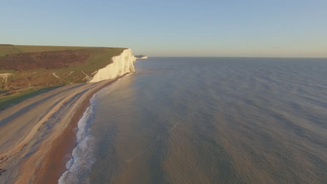 aerial shot of mouth of cuckmere river - english channel stock videos and b-roll footage