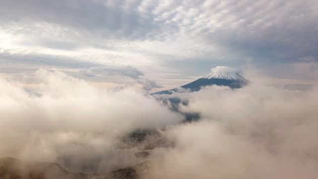 aerial shot of mt.fuji above the clouds and sky , kawaguchiko , japan - mt fuji stock videos & royalty-free footage