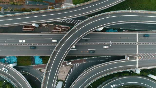 aerial shot of multiple lane highway - autostrada a corsie multiple video stock e b–roll