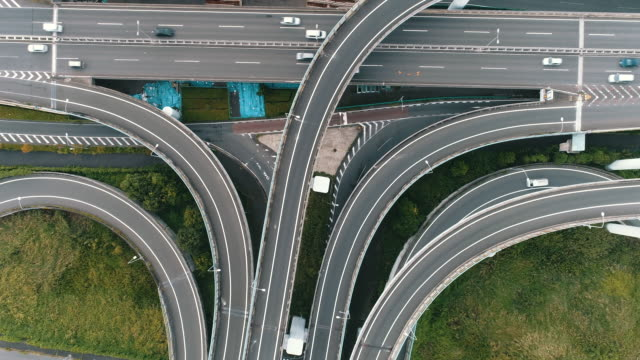 aerial shot of multiple lane highway - motorway stock videos & royalty-free footage