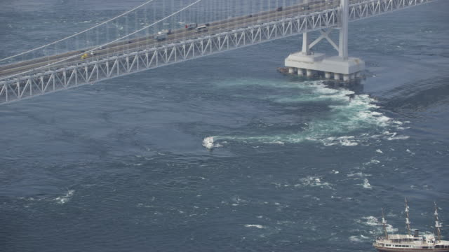 "aerial shot of naruto whirlpools called ""uzusio"", japan. - tokushima prefecture stock videos & royalty-free footage"