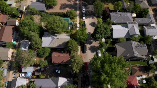 aerial shot of neighborhood to downtown city reveal - finding stock videos & royalty-free footage