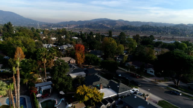 aerial shot of neighborhood - high street stock videos & royalty-free footage