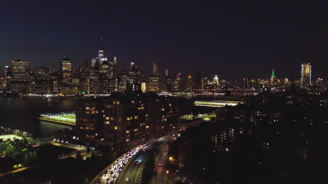 aerial shot of new york city and brooklyn at night - brooklyn new york video stock e b–roll