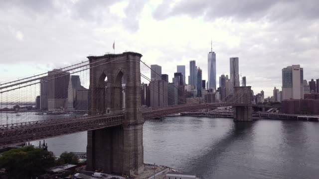 aerial shot of new york city on a cloudy morning. - brooklyn bridge stock videos & royalty-free footage