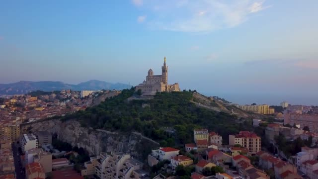 aerial shot of notre-dame de la garde, marseille - basilica video stock e b–roll