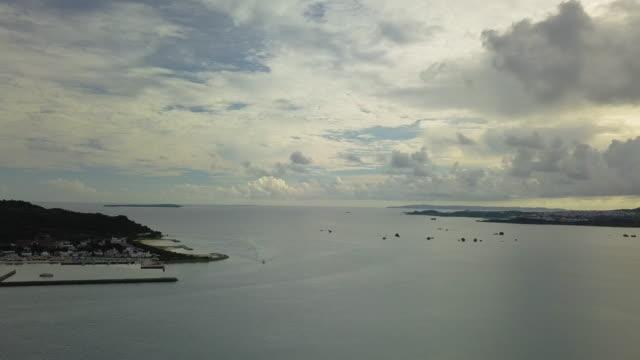 aerial shot of ocean,road and sky. - satoyama scenery stock videos & royalty-free footage