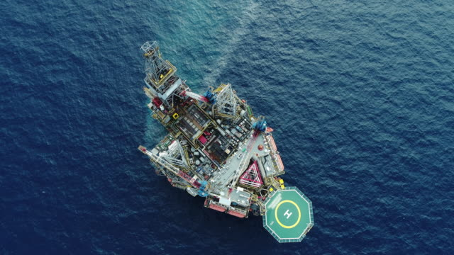 aerial shot of off shore oil platforms working close up day time stock video - essential oil stock videos & royalty-free footage
