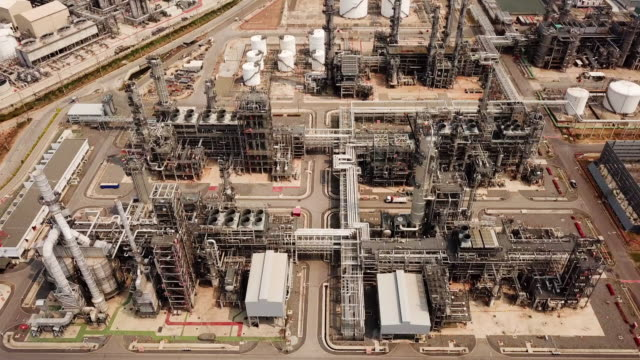 aerial shot of oil refinery plant - chemical stock videos & royalty-free footage