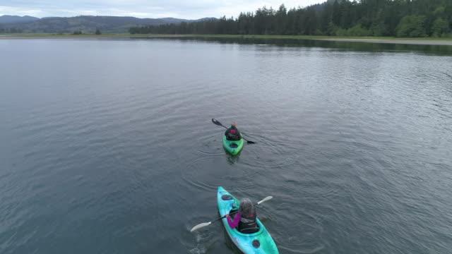 aerial shot of older couple kayaking - pacific islander stock videos & royalty-free footage