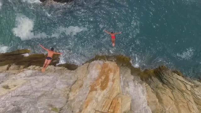 vidéos et rushes de aerial shot of one side of la quebrada in acapulco mexico - cliff