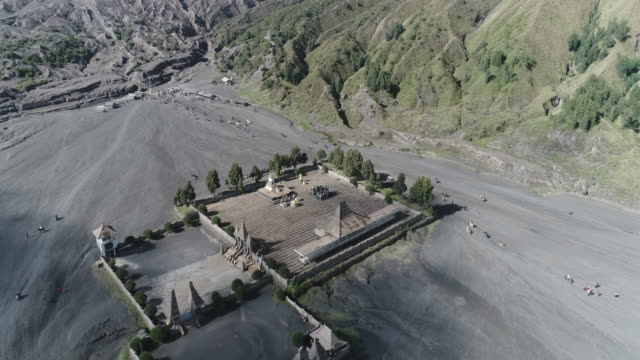 aerial shot of park in front of mount bromo. - mount bromo stock videos & royalty-free footage