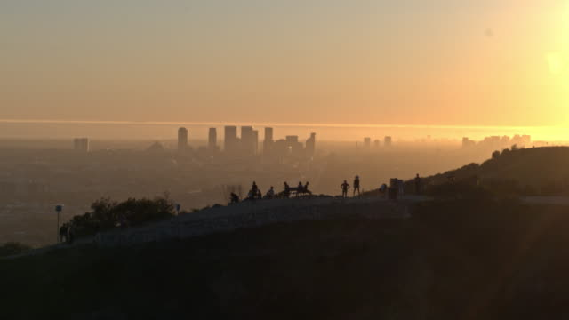 aerial shot of people hiking runyon canyon in hollywood at sunset - canyon stock videos & royalty-free footage
