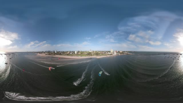 360 VR Aerial shot of people kite surfing in St Kilda