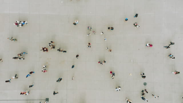 aerial shot of people walking - above stock videos & royalty-free footage
