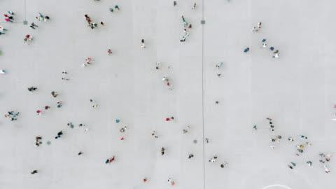 aerial shot of people walking - crowd of people stock videos & royalty-free footage