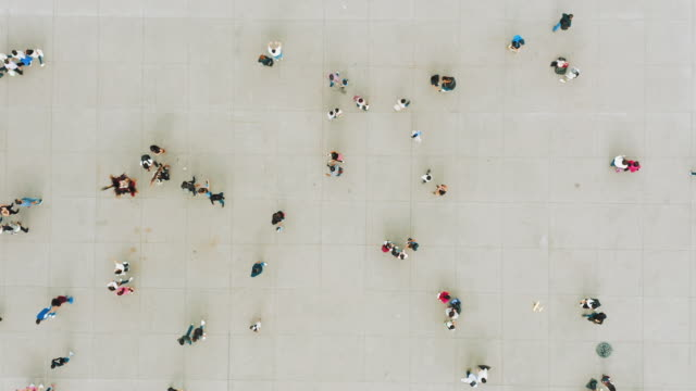 aerial shot of people walking - aerial view stock videos & royalty-free footage