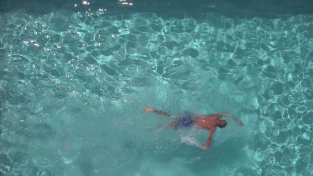 aerial shot of person swimming in a pool - utebassäng bildbanksvideor och videomaterial från bakom kulisserna
