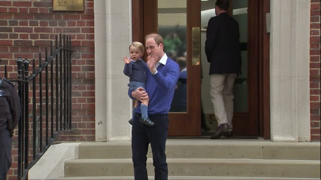 aerial shot of prince william duke of cambridge and prince george arriving at st marys hospital to meet his new sister the royal princess of... - 2015 stock videos & royalty-free footage