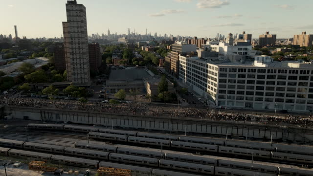 aerial shot of protesters marching through the streets of brooklyn, new york city. shot at dusk near barclays center in 4k. - persona irriconoscibile video stock e b–roll