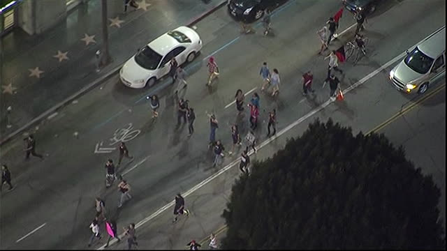 aerial shot of protesters on the streets of los angeles after george zimmerman is acquitted for the murder of trayvon martin - crime or recreational drug or prison or legal trial stock-videos und b-roll-filmmaterial