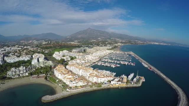 aerial shot of puerto banus in costa del sol - marina stock videos & royalty-free footage