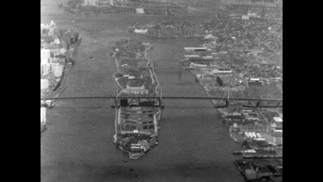 aerial shot of queensboro bridge crossing over roosevelt island, new york city - harlem stock videos & royalty-free footage
