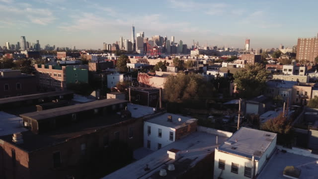 aerial shot of red hook, brooklyn with new york city and the world trade center in the background. - brooklyn new york stock videos & royalty-free footage
