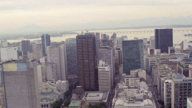 vídeos de stock, filmes e b-roll de aerial shot of rio de janeiro cityscape in brazil - centro da cidade