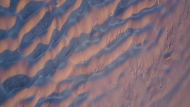 aerial shot of rippled sand on remote beach on washington coast - natural pattern stock videos & royalty-free footage