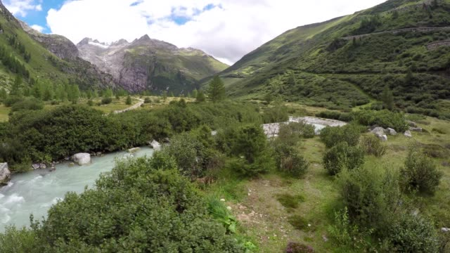 Aerial shot of river and footpath in mountain landscape