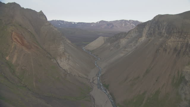 aerial shot of river valley leading to aniakchak caldera, alaska, september 2010 - caldera stock videos and b-roll footage