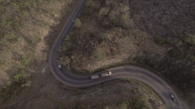 aerial shot of road in the hill