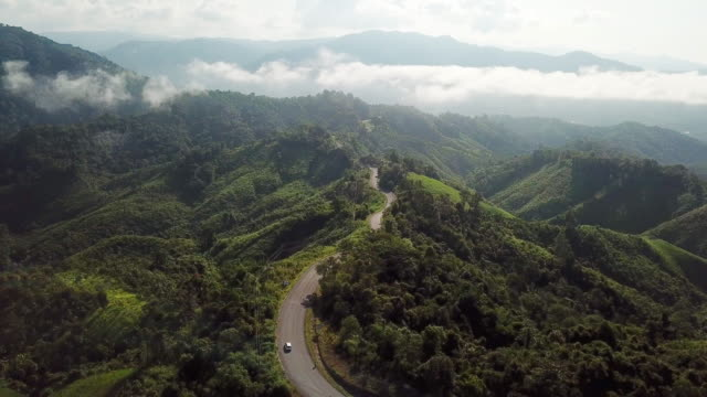 aerial shot of road in the mountain , driving concept - overcast stock videos & royalty-free footage