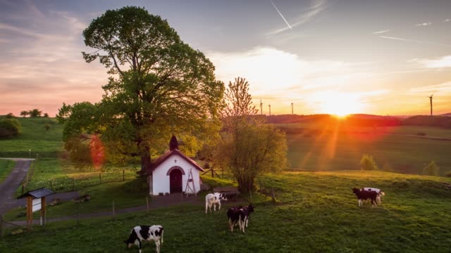 Aerial shot of rural landscape in Germany at sunset