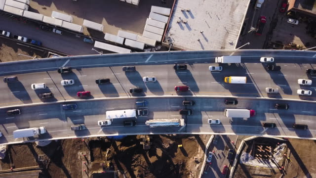 aerial shot of rush hour traffic - ora di punta video stock e b–roll