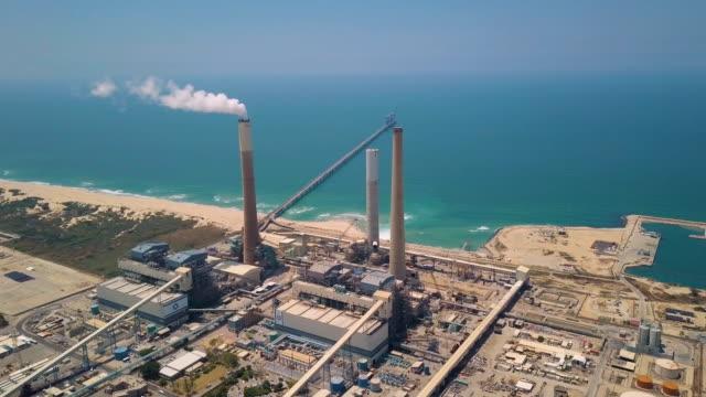 aerial shot of rutenberg power station with mediterranean sea in background/ ashkelon - mediterranean sea stock videos & royalty-free footage