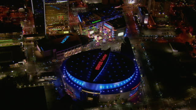 aerial shot of la's staples center at night - staples centre stock videos & royalty-free footage