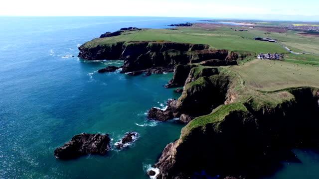 Aerial shot of sea cliffs off the coast of Scotland near Aberdeen