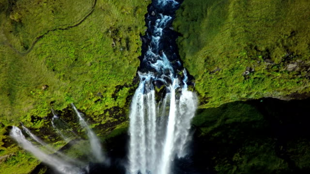 aerial shot of seljalandsfoss waterfall in iceland - waterfall stock videos & royalty-free footage