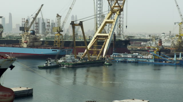 Aerial shot of ships docked at Dubai Drydocks in Dubai, United Arab Emirates.