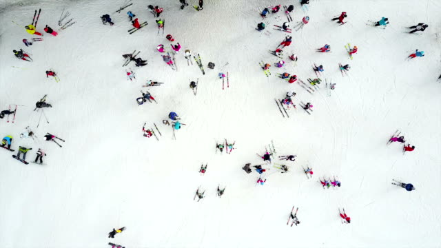 aerial shot of skiers preparing to ski - skiing stock videos & royalty-free footage