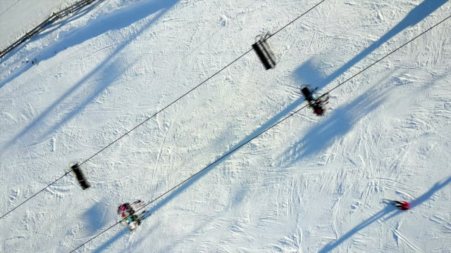 aerial shot of skiers preparing to ski - skiing and snowboarding stock videos and b-roll footage