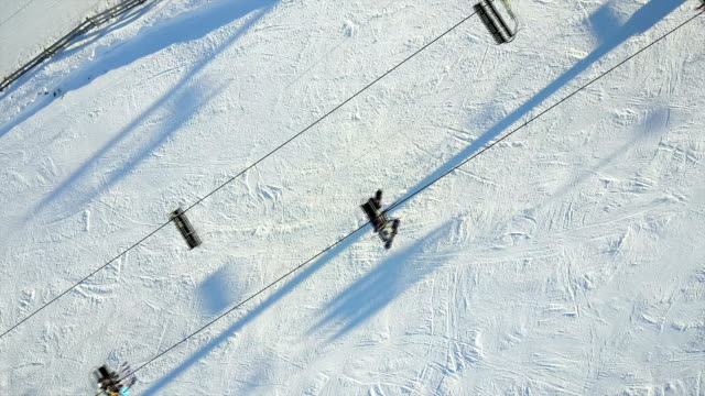 aerial shot of skiers preparing to ski - seggiovia video stock e b–roll