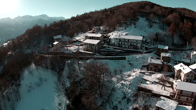 Aerial shot of small towns and mountains in Piedmont